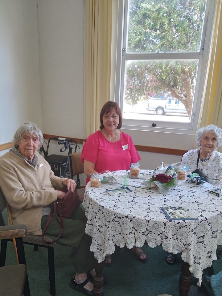 Jan and guests at over 90's morning tea