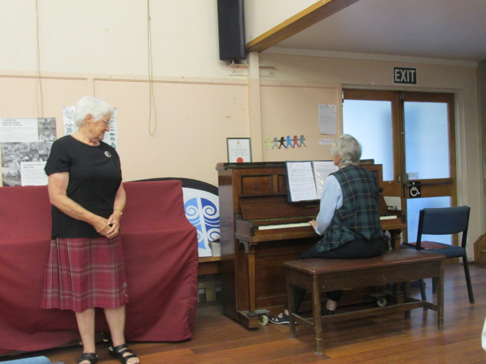 Marion singing with Val on piano