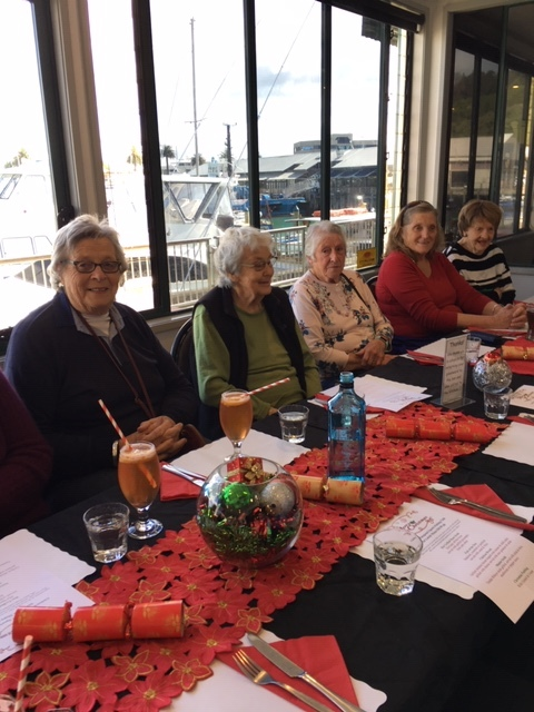 members enjoying mid winter christmas lunch